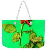 Dying Flower Against A Green Background Weekender Tote Bag