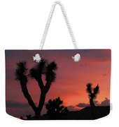 Joshua Trees Silhouetted Against A Red Sky Weekender Tote Bag