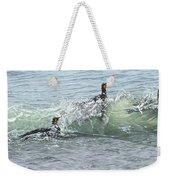 King Penguins Swimming In The Waves Weekender Tote Bag by Alan M Hunt