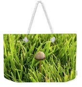 Lonely Little Mushroom Floating On The Grass Weekender Tote Bag