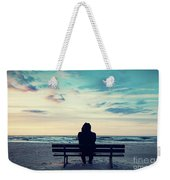 Man In Hood Sitting On A Lonely Bench On The Beach Weekender Tote Bag