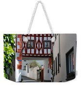 old historic street and woodframed house in Ediger Germany Weekender Tote Bag