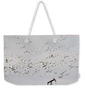 Snow Geese Over Oil Pump 01 Weekender Tote Bag by Rob Graham