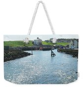 sunlight glistening on water at Eyemouth harbour Weekender Tote Bag