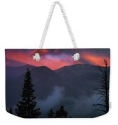 Sunset Storms Over The Rockies Weekender Tote Bag by John De Bord