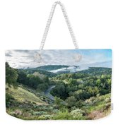 View Of Curved Road Through Dense Forest Area With Low Clouds Ov Weekender Tote Bag