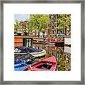 Boats On Canal In Amsterdam Framed Print