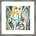 Angel Sheltering Seven Swans Framed Print