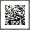 Bicyles Parked Along The Street Framed Print