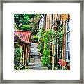 Cottage Row Framed Print by Dave Woodbridge