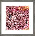 Hiking On The Cracked Purple Earth Framed Print