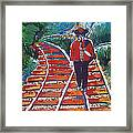 Man Walking On Rails Framed Print