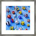 Marbles On Blue Board Framed Print