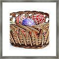 painted Easter Eggs in wicker basket Framed Print