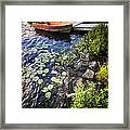 Rowboat At Lake Shore Framed Print