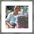Salesman In The Marketplace In Tachilek-burma Framed Print