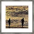 Strangers On A Shore - Walking Silhouettes Framed Print