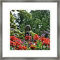 Girl Behind Red Geraniums Framed Print