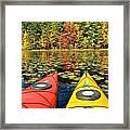 Kayaks In The Fall Framed Print