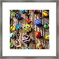 Marbles On Wooden Board Framed Print