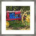 Red And Yellow Tractor Framed Print
