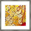 Red Thread And Yellow Buttons Framed Print