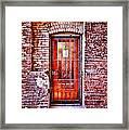 Urban Door In Old Brick Building Framed Print