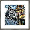 Walking Down The Street Of Amsterdam Framed Print