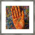 Orange Wooden Hand Holding Paperclips Framed Print