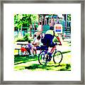 Police Officer Rides A Bicycle Framed Print