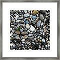 Rocks And Sticks On The Beach Framed Print