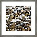 Stones And Snow Framed Print