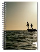 A Couple Fish As A Man Pilots A Small Spiral Notebook