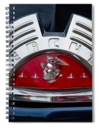 Close-up Of A Mercury Classic Car Of Spiral Notebook