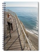Elevated Perspective Of Woman Riding Spiral Notebook