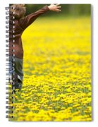 Young Boy Running Through Field Of Spiral Notebook