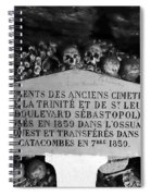 A Marker With Skulls And Bones In The Catacombs Of Paris France Spiral Notebook