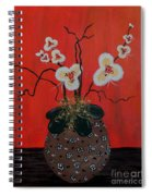 Orchids In A Pot On Orange Spiral Notebook