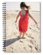 A Cute Little Hispanic Girl Wearing Spiral Notebook
