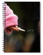 A Hand Holding A Cigarette Spiral Notebook