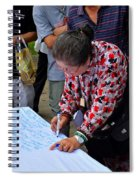 A Lady Signs Petition At May Day Rally Singapore Spiral Notebook