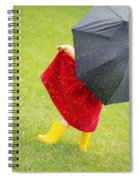 A Little Girl Walking In The Rain While Spiral Notebook