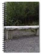 A Long Stone Section Over Wooden Stumps Forming A Rough Sitting Area Spiral Notebook
