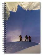 A Man Stands At The Entrance Of An Ice Spiral Notebook