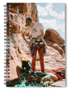 A Rock Climber Setting Up To Climb Spiral Notebook