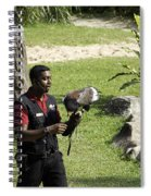 A Trainer And A Large Bird Of Prey At A Show Inside The Jurong Bird Park Spiral Notebook