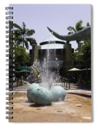 A Water Fountain With Dinosaur Eggs And Dinsosaurs In Universal Studios Spiral Notebook