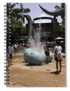 A Water Fountain With Dinosaur Eggs In Universal Studios Singapore Spiral Notebook
