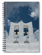 A Whitewashed Bell Tower And Dramatic Spiral Notebook
