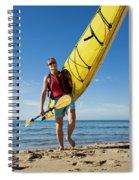 A Woman Carrying Her Sea Kayak Spiral Notebook